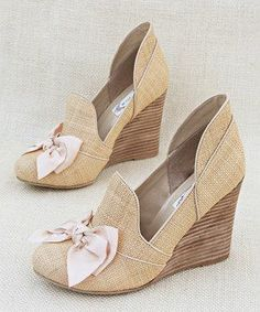 beige wedges with bows.