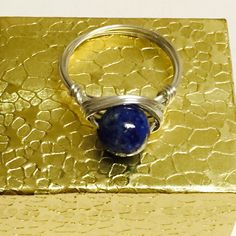Made a blue lapis silver wire wrapped ring!