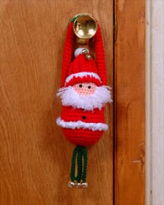 Santa Door Greeter This sweet little guy will be a wonderful addition to your holiday decor! Materials: Worsted weight yarn - Red (2 oz), White (1 oz), Green (1 oz), Peach (1 oz) Size ...