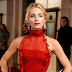 Annabelle Wallis at the BAFTA 2016 in Chopard ruby and diamond earrings, and a Fairmined gold ring set with marquise-cut diamonds.