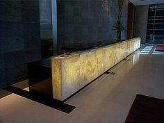Receptionist desk with backlit stone