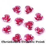 Diese wunderschönen Rosen aus Metall in Rosa sind ideal zum Verzieren