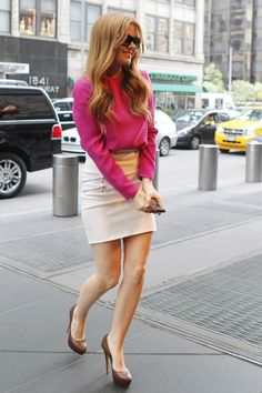 Isla Fisher, wearing a bright pink top and white skirt, happily greets fans as she heads out to promote her new film 'The Great Gatsby' in New York City. (April 30, 2013)