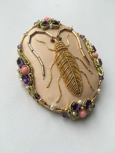 Goldwork embroidery beetle done by Larissa Borodich, design by Jane Nicholas. Brooch made by Olesya Bryutova.