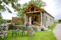Nant a self catering barn conversion on a traditional working welsh hill farm in Snowdonia. Real log fire, underfloor heating, oak beams and high vaulted ceilings.