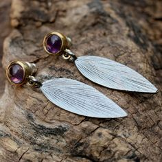 Silver leaf dangle earrings with small round amethyst cabochon in brass setting