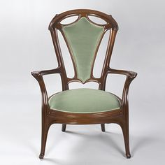 A French Art Nouveau carved mahogany armchair by Jacques Gruber