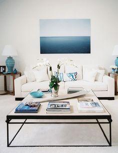 Blue hues and white living room from Golden White Decor.