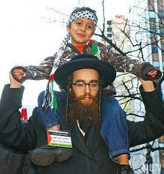 Islamic Pictures — An Anti Zionism Jew carrieng a palestinian child...