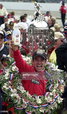 Racecar driver Helio Castroneves of Brazil celebrates 27 May, 2001 after winning the 85th running of the Indianapolis 500 at the Indianapolis Motor Speedway in Indianapolis, IN. Castroneves won the race for the first time and the eleventh time for car owner Roger Penske