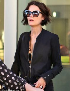 Image from http://i.dailymail.co.uk/i/pix/2015/06/04/11/2958C19100000578-3110731-Plunging_jumpsuit_Jaimie_Alexander_was_spotted_arriving_in_Toron-m-26_1433414842259.jpg.