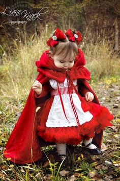 Cute little red riding hood fairy tale kids' costume. This picture goes to the Etsy store to buy the Red Hair Bow Clips Chunky Big with Rhinestone Bling.