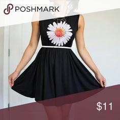 Summer / spring stretchy black dress with Daisy pr Fun and flirty little black dress made from a stretchy fabric with a daisy flower print in SMALL. Fitted at the waist.   New - never worn. Dresses Mini