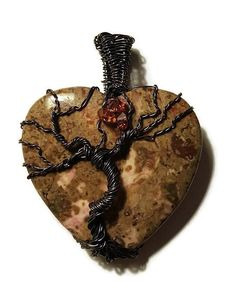 Tree of Life Stone Pendant - is made with antiqued bronze wire. It is wired onto a beautiful jasper stone heart which measures 50x34x7mm. 3 genuine swarovski crystals sit at the top like a small moon. This comes on a black leather cord. (18 inch). | Shop this product here: http://spreesy.com/jodysbeads/1 | Shop all of our products at http://spreesy.com/jodysbeads    | Pinterest selling powered by Spreesy.com