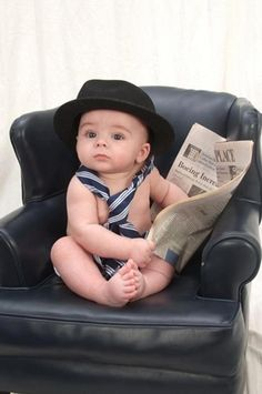 Adorable little man reads the newspaper
