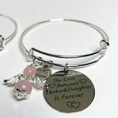 "These gorgeous bangles come in 2 sizes, child and adult, the angel is usually rose quartz which is all about love. The disc charm has a beautiful saying on it ""a love between mother and daughter is forever"" and a charm with best friend in it. Personalised Bauble, Bespoke Jewellery, Initial Charm, Bangles, Bracelets, Rose Quartz, Daughters, Christmas Gifts, Jewelry Making"