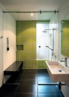 We love the green patterned wall in this very stylish bathroom—what a lovely splash of soothing color in the black and white theme! The sanitary ware is sleek and trendy while the bench is an innovative addition to the bathroom! Mi Casita : Carmen's: modern Bathroom by KUBE Architecture