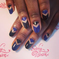 Negative space chevrons by Neringa Nails
