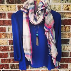 Royal blue, plaid scarf, and jewels. What could be better?