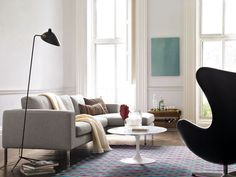 Neo Sectional shown with Serge Mouille One-Arm Floor Lamp, Saarinen Coffee Table and Egg Chair   #dwr #living_room #dwr_Living_Room_Sale