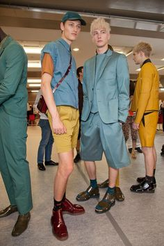 I know this is high fashion and all, but I can't help but laugh. They all look like little boys trying to wear clothes too small or too big for them. Kenzo Men's Backstage S/S '13