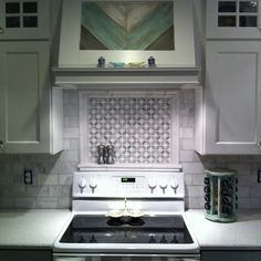 A Focal Point Over The Range Is Striking With Crackled Glass Tile