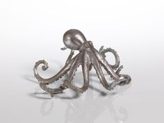 """This Decorative Octopus adds a beach element to any coastal home and makes the perfect gift for anyone loving sea life. Dimensions: 9.5""""H x 8.75""""W x 4.5""""D"""