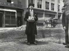 Blind Beggar by Jacob Riis:  Jacob A. Riis was a police reporter in 1877 and decided to document the people living in New York's East Side slum district. His book, How the Other Half Lives: Studies Among the Tenements of New York, was the result of these photographs and was published in 1890.  With remorseless candor, he documents the filth, disease, exploitation, and overcrowding that characterized the experience of more than one million immigrants.
