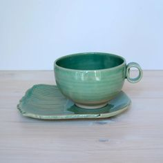 stoneware tea cup and saucer