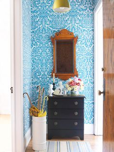 Create drama with a bold color patterned wallpaper