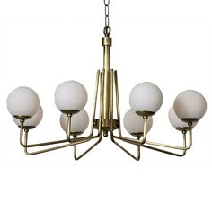 The Ray's Chandelier by Noir emphasizes natural, simple and classic design. Noir has been designing, building and importing a very unique, but ever growing collection of home furnishings for more than 10 years.    <i>Noir products are hand finished and created with a concentrated effort toward environmental sustainability. Variations could occur and are not considered as product defects.</i>    Materials: Metal