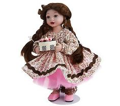 A Treat for Mom Porcelain Doll by Marie Osmond  cute little doll Marie pays a lot of attention to details on her dolls....