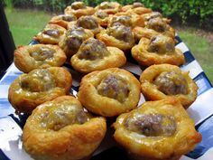 Sausage Biscuit Bites - 2 -10ct cans flaky biscuits, 1 lb sausage, 2 cups of shredded cheddar cheese preheat at  400 8 to 10 min