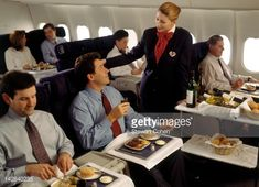 executive-enjoying-inflight-meal-with-wine-picture-id142840235 (486×352)