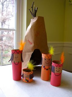 Native American family: cardboard toilet paper/paper towels tubes, construction paper.  Tipi:  sticks, rubber band, paper grocery bag.