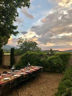 table set for dinner in Provence with sun setting Our Stay in a #farmhouse  Manor in #Provence...see the interiors and grounds!