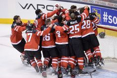 Canadian players celebrate Canada's 5-4 victory over Russia during the gold medal game hockey action at the IIHF World Junior Championship in Toronto. Jan 5, 2015.