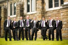 Mr. Snow Cone and his groomsmen posed for portraits before the ceremony, showcasing their pinstripe charcoal gray suits and purple ties