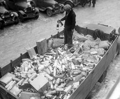 A Prohibition agent stands in a flatbed of confiscated alcohol at the Trumbull Street Police Station on Detroit's West Side.