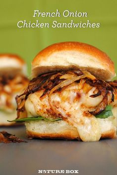 French Onion Chicken Sandwiches 1 tablespoon extra virgin olive oil 1 large white onion, thinly sliced 1 teaspoon granulated sugar Olive oil nonstick cooking spray 2 boneless, skinless chicken breasts, halved crosswise and pounded to 1-inch thickness, if necessary 4 slices Swiss cheese 4 hamburger buns 2 cups baby spinach