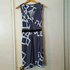 New York & Company Stretch Dress Elegant, sleeveless square print dress. It has an elastic waist. It is 95% polyester and 5% spandex. It has a beautiful pleated front. It can be dressed up for a wedding party or dressed casual with wedges for a birthday party or brunch. Used once, like new. New York & Company Dresses Midi