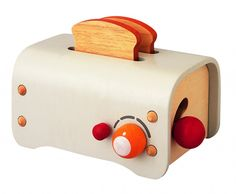Love this toy toaster! Plan Toys