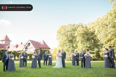 We love this picture of Kelly and Greg and their wedding party outside St Clements Castle.