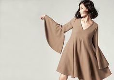 fa0f6f5948 Why We Love the Universally Flattering Pleated Skirt | style inspiration | Pleated  skirt, Skirts, Fashion