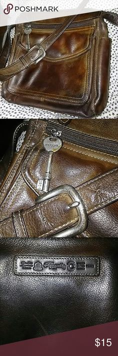 Vintage Fossil Leather Crossbody Bag A little rugged Vintage Fossil Crossbody Bag,  leather still in good condition silver hardware is a little tarnished. But I think it gives it character. Great Bag. Please see all pics. Fossil Bags Crossbody Bags