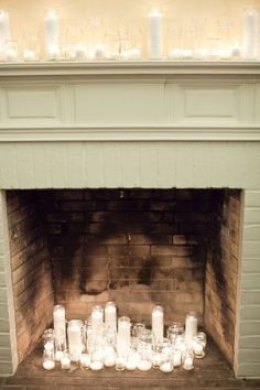 Perfect arrangement of candles and jars for the fireplace-like displays. Google Image Result for http://cache.elizabethannedesigns.com/blog/wp-content/uploads/2011/06/Candles-in-Fireplace-300x450.jpg