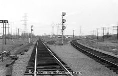 """ocation: Ottawa, Wass, ON  Railway Name: CANADIAN NATIONAL RAILWAYS  Date: 1969-05-00  Caption: """"CNR left track to Union station, right track to Walkley yard."""""""
