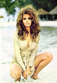 Raquel Welch is the brunette bombshell... Hair, makeup... lovvvvve