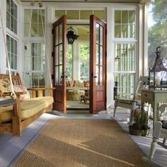 screened in porch with swing,and French doors... I think so