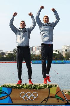 Jan Vandrey (R) and Sebastian Brendel (L) of Germany celebrate winning the gold medal in the Men's Canoe Double 1000m Finals on Day 15 of the Rio 2016 Olympic Games at the Lagoa Stadium on August 20, 2016 in Rio de Janeiro, Brazil.